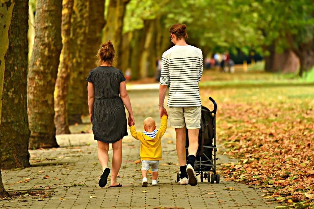 Family walking in a garden, family health services in GPs on Curzon