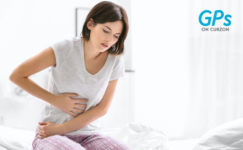 A woman suffering from abdominal pain due to endometriosis, Female GP Toowoomba