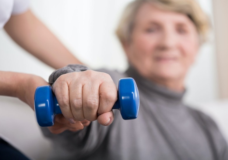 A senior woman doing weight bearing exercise as a reminder to take care of her bone health