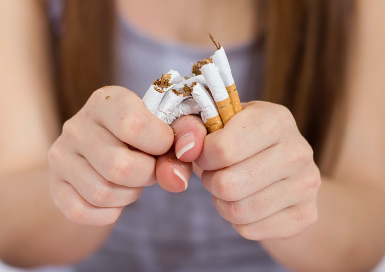 A woman quitting to smoking as a reminder to take care of her bone health