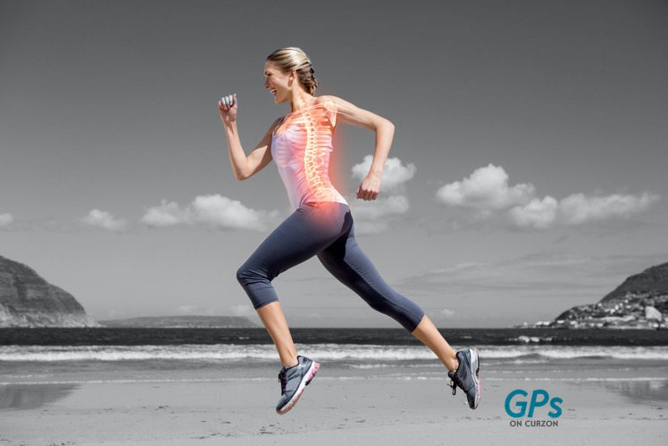 A woman running in the beach as a reminder to take care of her bone health